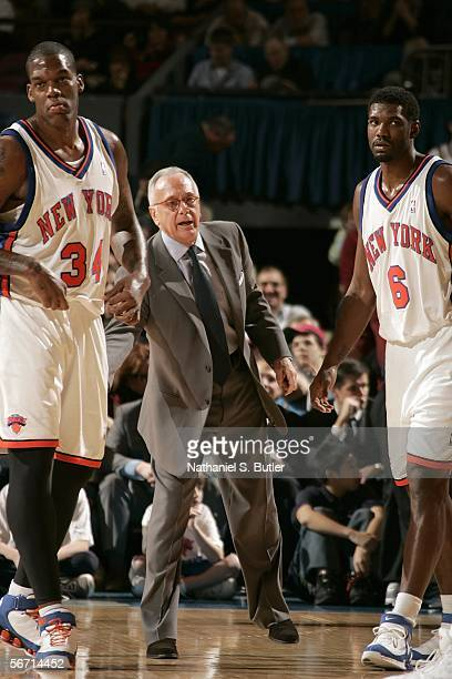 Head Coach Larry Brown with Eddy Curry and Qyntel Woods of the New York Knicks stand on the court against the Los Angeles Lakers on January 31 2006...