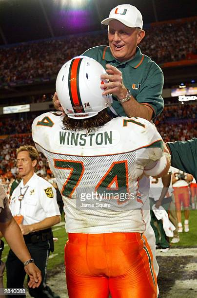 Head coach Larry Coker of the Miami Hurricanes is lifted by lineman Eric Winston after the Hurricanes defeated the Florida State Seminoles 1614 to...