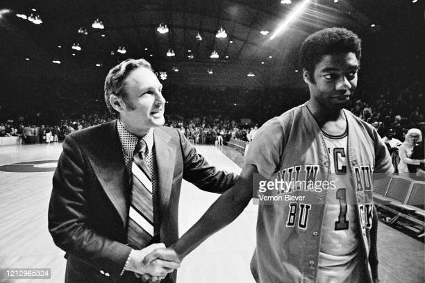 Head coach Larry Costello of Milwaukee Bucks and Oscar Robertson of Milwaukee Bucks talks during the game against the Los Angeles Lakers circa 1973...