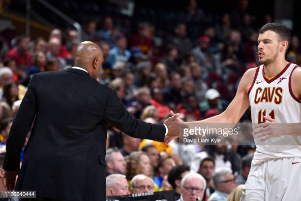 Head Coach Larry Drew hifives Ante Zizic of the Cleveland Cavaliers on February 21 2019 at Quicken Loans Arena in Cleveland Ohio NOTE TO USER User...