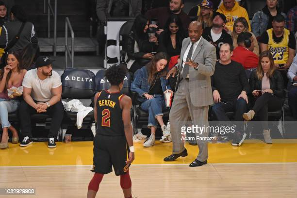 Head Coach Larry Drew of the Cleveland Cavaliers talks with player Collin Sexton of the Cleveland Cavaliers during the game against the Los Angeles...