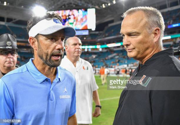 Head coach Larry Fedora of the North Carolina Tar Heels and head coach Mark Richt of the Miami Hurricanes shake hands after the game between the...