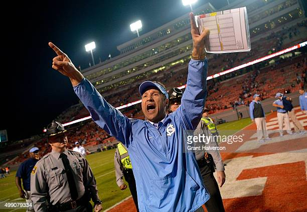 Head coach Larry Fedora of the North Carolina Tar Heels celebrates after a win over the North Carolina State Wolfpack at CarterFinley Stadium on...