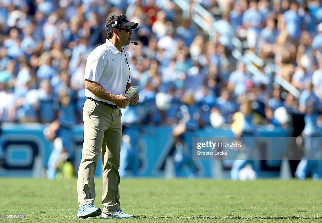 Head coach Larry Fedora of the North Carolina Tar Heels watches on against the Virginia Tech Hokies during their game at Kenan Stadium on October 4, 2014 in Chapel Hill, North Carolina.