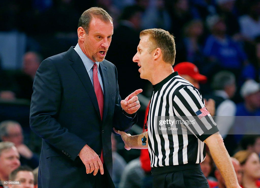 head coach Larry Krystkowiak of the Utah Utes argues with a referee against the Duke Blue Devils during the Ameritas Insurance Classic at Madison Square Garden on December 19, 2015 in New York City.