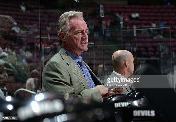 Head Coach Larry Robinson of the New Jersey Devils looks on from the bench during a preseason game against the New York Islanders at the Continental...