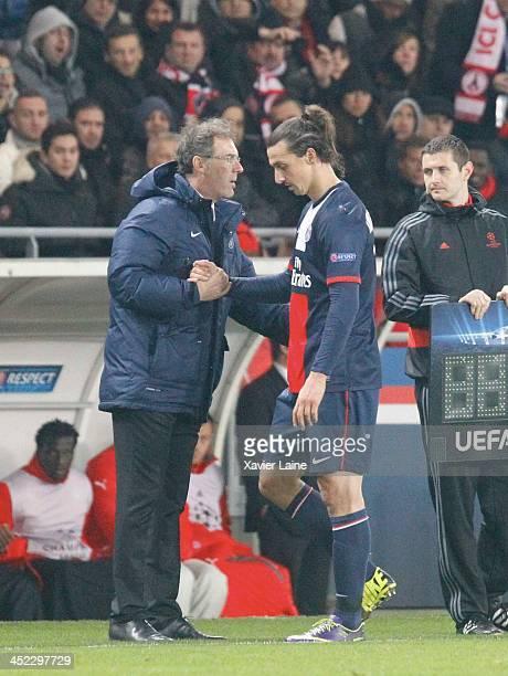 Head coach Laurent Blanc and Zlatan Ibrahimovic of Paris SaintGermain during the UEFA Champions League between Paris SaintGermain FC and Olympiacos...