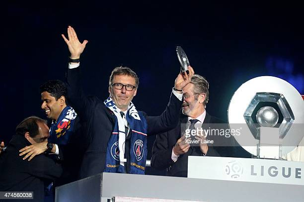 Head coach Laurent Blanc of Paris SaintGermain celebrates winning the championship after the French Ligue 1 game between Paris SaintGermain FC and...