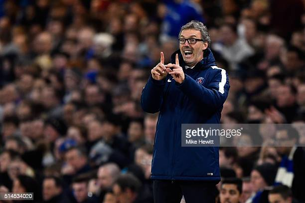 Head Coach Laurent Blanc of PSG directs his players during the UEFA Champions League round of 16 second leg match between Chelsea and Paris Saint...