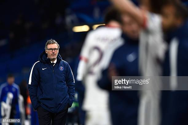 Head Coach Laurent Blanc of PSG watches his players celebrate their 21 victory during the UEFA Champions League round of 16 second leg match between...