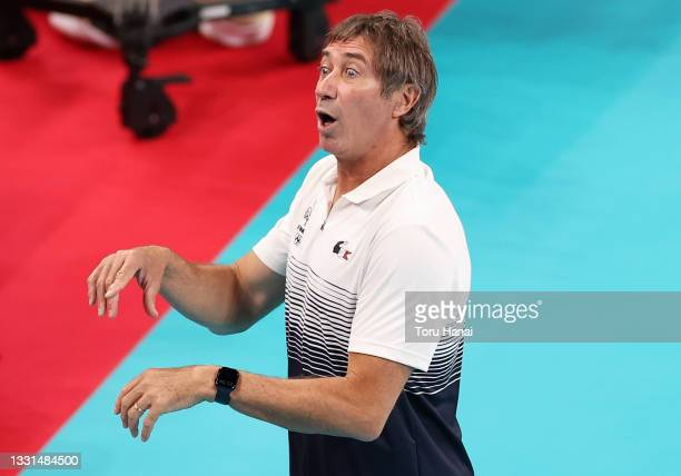 Head Coach Laurent Tillie of Team France reacts as he watches players against Team ROC during the Men's Preliminary Round - Pool B volleyball on day...