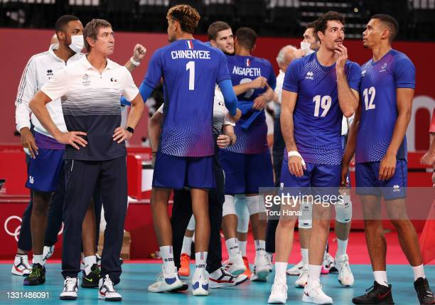 Head Coach Laurent Tillie of Team France reacts with players after they defeated Team ROC during the Men's Preliminary Round - Pool B volleyball on...