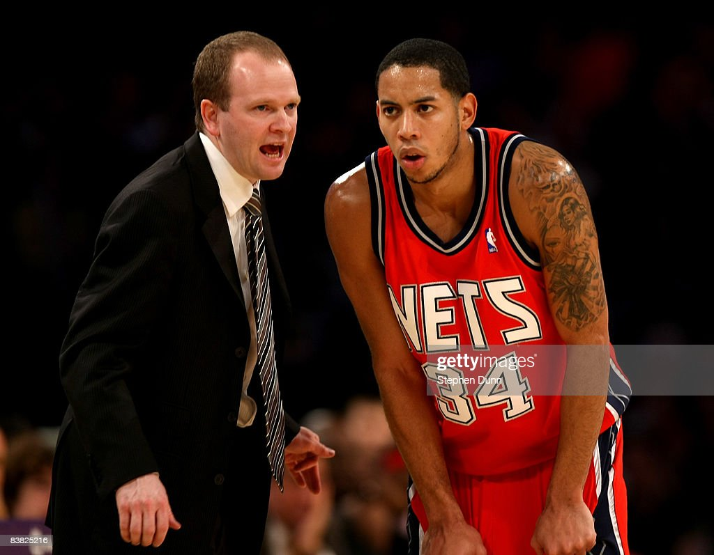 Head coach Lawrence Frank and Devin Harris #34 of the New Jersey Nets confer during the game with the Los Angeles Lakers on November 25, 2008 at Staples Center in Los Angeles, California. The Lakers won 120-93.