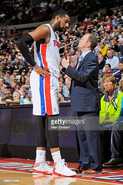 Head Coach Lawrence Frank of the Detroit Pistons speaks with Andre Drummond during a game against the Chicago Bulls on April 7 2013 at The Palace of...