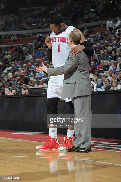 Head Coach Lawrence Frank of the Detroit Pistons speaks with Andre Drummond of the Detroit Pistons during the game between the Detroit Pistons and...