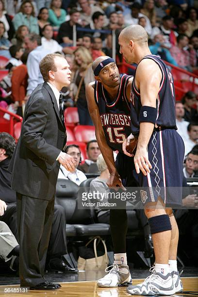 Head Coach Lawrence Frank, Vince Carter and Jason Kidd of the New Jersey Nets lead their team against the Miami Heat on December 23, 2005 at American...