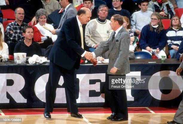 Head coach Lefty Driesell of the James Madison Dukes shakes the hand of the opposing coach Billy Tubbs of the Oklahoma Sooners after an NCAA College...