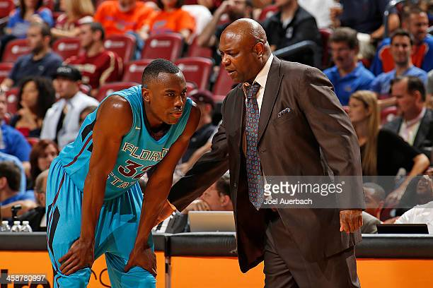 Head Coach Leonard Hamilton talks to Montay Brandon of the Florida State Seminoles during a break in action against the Massachusetts Minutemen...