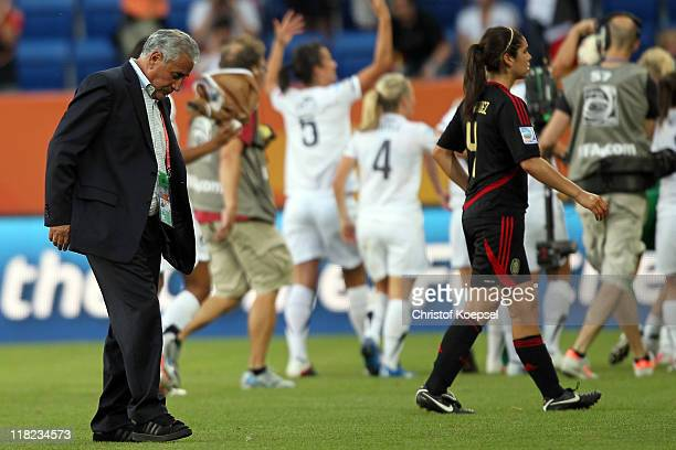 Head coach Leonardo Cuellar of Mexico and Alina Garciamendez of Mexico look dejecdted after the 22 draw of the FIFA Women's World Cup 2011 Group B...