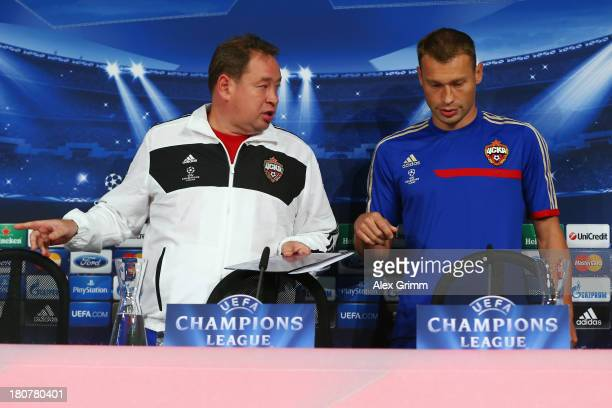 Head coach Leonid Slutski and Vasili Berezutski arrive for a CSKA Moscow press conference ahead of their UEFA Champions League Group D match against...