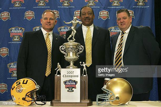 Head coach Les Miles of Lousiana State University Field Vice President Allstate Insurance Company Ron Corbin and head coach Charlie Weis of...