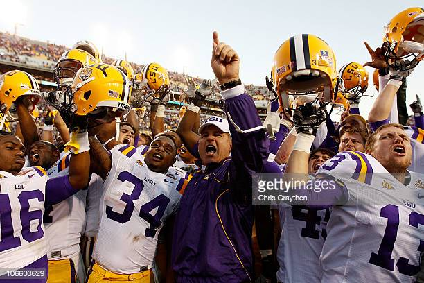 Head coach Les Miles of the Louisiana State University Tigers celebrates with his team after defeating the Alabama Crimson Tide 2421 at Tiger Stadium...