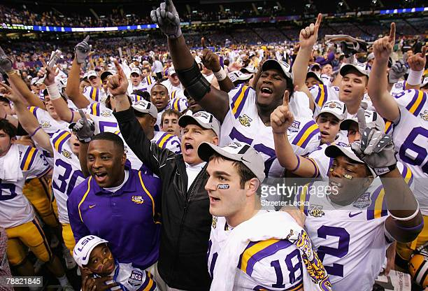 Head coach Les Miles of the Louisiana State University Tigers celebrates with his team after defeating the Ohio State Buckeyes 38-24 in the AllState...