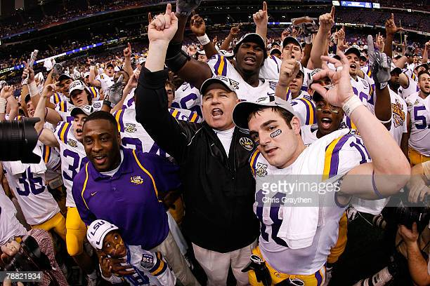 Head coach Les Miles of the Louisiana State University Tigers celebrates with Jacob Hester after defeating the Ohio State Buckeyes 3824 in the...