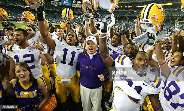 Head coach Les Miles of the LSU Tigers and team celebrate their 403 win over the Miami Hurricanes in ChickfilA Peach Bowl on December 30 2005 at the...