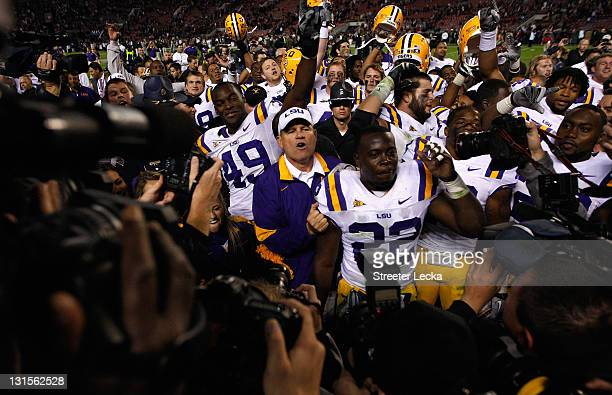 Head coach Les Miles of the LSU Tigers celebrates with his team after defeating the Alabama Crimson Tide 96 in overtime at BryantDenny Stadium on...