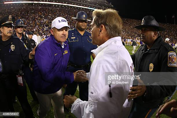 Head coach Les Miles of the LSU Tigers congratulates head coach Nick Saban of the Alabama Crimson Tide after the Tide defeated the Tigers 2013 in...
