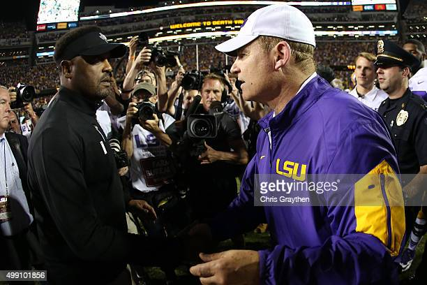 Head coach Les Miles of the LSU Tigers talks with head coach Kevin Sumlin of the Texas AM Aggies 197 at Tiger Stadium on November 28 2015 in Baton...