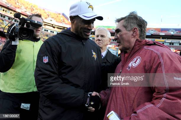 Head coach Leslie Frazier of the Minnesota Vikings and head coach Mike Shanahan of the Washington Redskins shake hands after the game at FedEx Field...