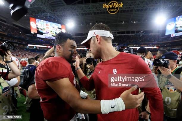 Head coach Lincoln Riley and Tua Tagovailoa of the Alabama Crimson Tide embrace after the win against the Oklahoma Sooners during the College...