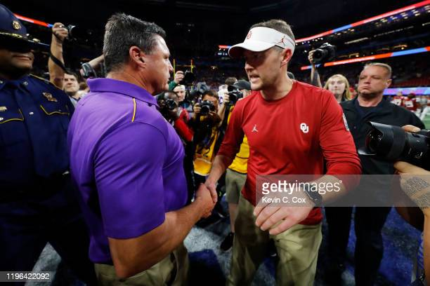 Head coach Lincoln Riley of the Oklahoma Sooners and head coach Ed Orgeron of the LSU Tigers shake hands after the LSU Tigers win the Chick-fil-A...