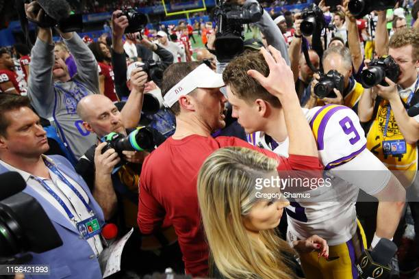 Head coach Lincoln Riley of the Oklahoma Sooners and quarterback Joe Burrow of the LSU Tigers embrace after LSU Tigers wins the Chick-fil-A Peach...