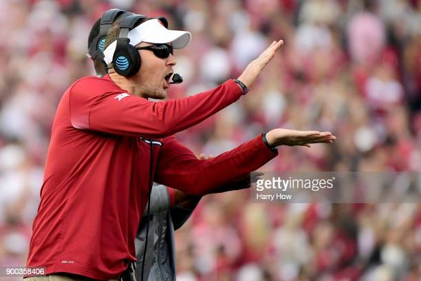 Head Coach Lincoln Riley of the Oklahoma Sooners calls a play from the sidelines in the 2018 College Football Playoff Semifinal Game against the...