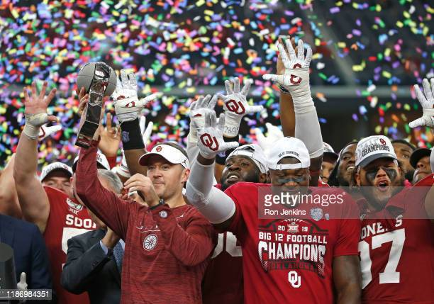 Head coach Lincoln Riley of the Oklahoma Sooners celebrates with his team after defeating the Baylor Bears 3023 in the Big 12 Football Championship...
