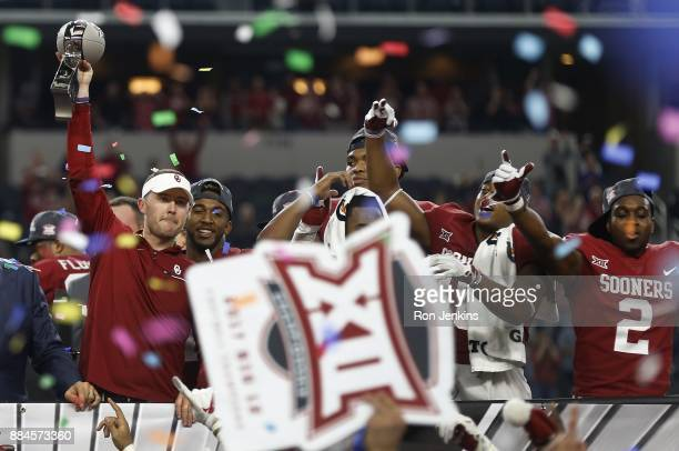 Head coach Lincoln Riley of the Oklahoma Sooners celebrates with his team after defeating the TCU Horned Frogs 4117 in the Big 12 Championship ATT...