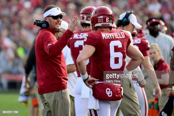Head Coach Lincoln Riley of the Oklahoma Sooners speaks to Baker Mayfield of the Oklahoma Sooners in the 2018 College Football Playoff Semifinal at...