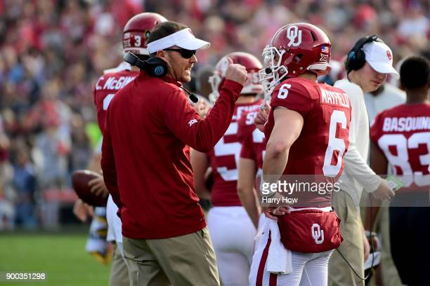 Head Coach Lincoln Riley of the Oklahoma Sooners speaks to Baker Mayfield of the Oklahoma Sooners in the 2018 College Football Playoff Semifinal Game...