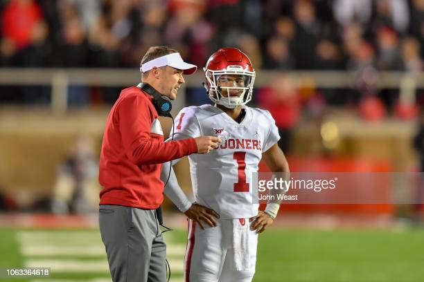 Head coach Lincoln Riley talks with Kyler Murray of the Oklahoma Sooners during the game against the Texas Tech Red Raiders on November 3 2018 at...