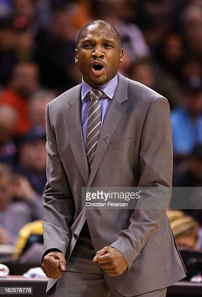 Head coach Lindsey Hunter of the Phoenix Suns reacts during the first half of the NBA game against the San Antonio Spurs at US Airways Center on...