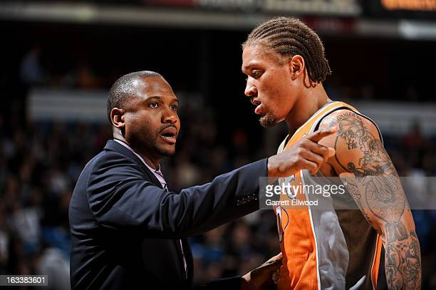 Head Coach Lindsey Hunter of the Phoenix Suns speaks with Michael Beasley during a game against the Sacramento Kings on March 8 2013 at Sleep Train...