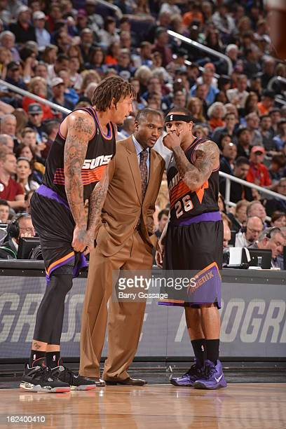 Head Coach Lindsey Hunter Shannon Brown and Michael Beasley of the Phoenix Suns have a conference against the Oklahoma City Thunder on February 10...