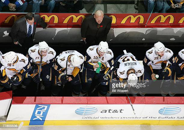 Head Coach Lindy Ruff and Assistant Coach James Patrick of the Buffalo Sabres stand behind the bench while playing the Toronto Maple Leafs on...