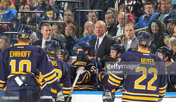 Head coach Lindy Ruff and assistant coaches James Patrick and Kevyn Adams of the Buffalo Sabres talk to players in a game against the New York...