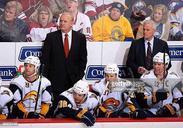 Head coach Lindy Ruff and Brian McCutcheon of the Buffalo Sabres watch from the bench during the NHL game against the Phoenix Coyotes at Jobingcom...