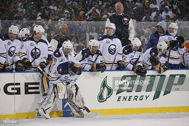 Head coach Lindy Ruff goaltender Ryan Miller and the rest of the Buffalo Sabres await the shootout against the Pittsburgh Penguins in the NHL Winter...