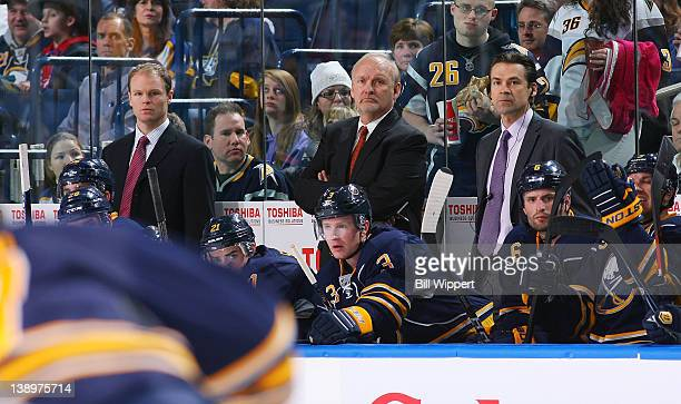 Head coach Lindy Ruff of the Buffalo Sabres returns behind the bench flanked by assistant coaches Kevyn Adams and James Patrick for their game...
